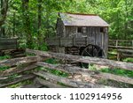 Old Wooden House With Water...