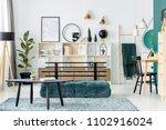 black table on carpet near... | Shutterstock . vector #1102916024