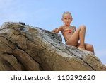 Girl on the rock - stock photo