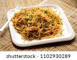 schezwan veg noodles is a spicy ... | Shutterstock . vector #1102930289