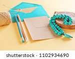 Small photo of Composition with envelope, card and beads on color background. Mail service