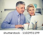 colleagues discussing project... | Shutterstock . vector #1102951199