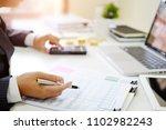 finance control close up hand...   Shutterstock . vector #1102982243