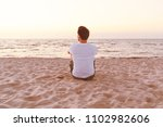 young man in a white t shirt... | Shutterstock . vector #1102982606