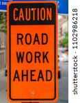 Small photo of Caution Road Work Ahead sign