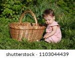 portrait of child outdoors.... | Shutterstock . vector #1103044439