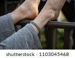 crossed feet relax foot... | Shutterstock . vector #1103045468