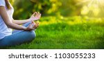 yoga woman meditating at sunset.... | Shutterstock . vector #1103055233
