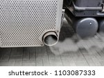 smoke from the exhaust pipe of... | Shutterstock . vector #1103087333