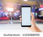 female holding blank screen... | Shutterstock . vector #1103088050