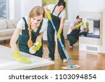 young member of a cleaning crew ... | Shutterstock . vector #1103094854