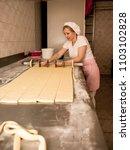 woman baker working in bakery... | Shutterstock . vector #1103102828