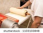 man baker working in bakery shop | Shutterstock . vector #1103103848