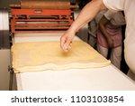 man baker working in bakery shop | Shutterstock . vector #1103103854