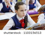 pupils at the desk think and... | Shutterstock . vector #1103156513