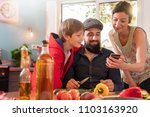 cheerful family sharing a good...   Shutterstock . vector #1103163920