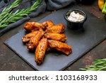 chicken wings in barbecue sauce | Shutterstock . vector #1103168933