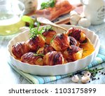 roasted new potatoes wrapped in ... | Shutterstock . vector #1103175899