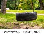 tire swing playground park... | Shutterstock . vector #1103185820