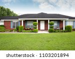 1980's brick ranch house in the ... | Shutterstock . vector #1103201894