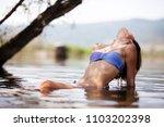 sexy girl posing in water.... | Shutterstock . vector #1103202398