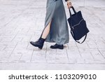 street style portrait of an... | Shutterstock . vector #1103209010