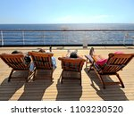 Cruise Ship Vacation. Four Cruise Guest Relaxing on the Deckchair. - stock photo