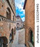 Small photo of View of the Basilica of Santa Maria Maggiore and Cappella Colleoni in Citta Alta of Bergamo, Italy between narrow streets