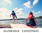 kids jumping off a boat into... | Shutterstock . vector #1103254643