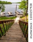 north woods lake dock boats... | Shutterstock . vector #1103257928