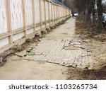 poor repair of road and... | Shutterstock . vector #1103265734
