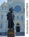 Small photo of Kronstadt, Russia- 27,05,2018 Monument holy righteous Admiral Fedor Ushakov near the Naval cathedral of St. Nicholas the Wonderworker (Nikolsky Stauropegic Naval Cathedral)