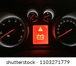 Stock photo car dashboard with low battery alert 1103271779