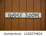 game room sign on wood painted... | Shutterstock . vector #1103274824