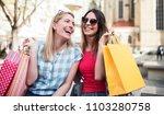 two smiling women enjoying in... | Shutterstock . vector #1103280758