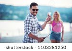 summer time. young couple... | Shutterstock . vector #1103281250