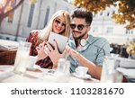 dating. young couple sitting in ... | Shutterstock . vector #1103281670