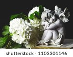angel and white flowers on dark ... | Shutterstock . vector #1103301146