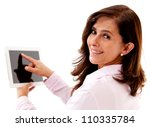 Businesswoman using tablet computer - isolated over a white background - stock photo