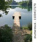 jetty on the telese lake | Shutterstock . vector #1103417270