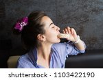 beautiful girl eating a cookie | Shutterstock . vector #1103422190