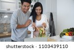 young husband and pregnant wife ... | Shutterstock . vector #1103439110