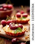 tarts with fresh cherries and... | Shutterstock . vector #1103450366