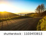 metalled rural road with baton... | Shutterstock . vector #1103453813
