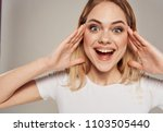 joyful woman holding her head   ... | Shutterstock . vector #1103505440
