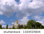 Small photo of beautiful summer landscape with Orthodox Church on blue sky and clouds background. Russia, Saransk city, Cathedral of the Holy warrior Fyodor Ushakov.
