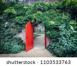 open  red  half round door in a ... | Shutterstock . vector #1103533763