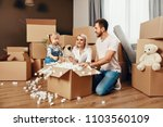 Stock photo family moving happy people with dog unpacking boxes moving in new cozy apartment high resolution 1103560109