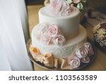wedding cake on the table | Shutterstock . vector #1103563589