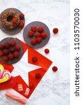 fresh raspberries background | Shutterstock . vector #1103570030